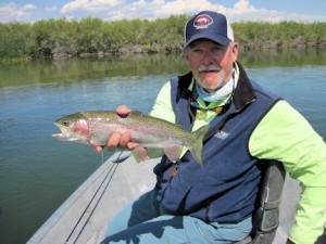 Mike Perez, from IN, with a rainbow trout caught and released on a dry fly while fishing out of Crane Meadow Lodge in Twin Bridges, MT.