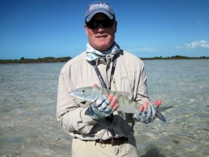 Tim Nolan, from Miami, FL, with one of his first bonefish caught and released on a fly while fishing out of Mars Bay Bonefish Lodge in South Andros, Bahamas.
