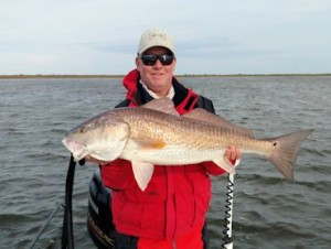Kirk Grassett, from Middletown, DE, with a big Louisiana red caught and released on a fly while fishing out of Hopedale, LA.