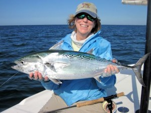 Nanette O'Hara, from Tampa, with a nice and her first false albacore on a fly while fishing the coastal gulf in Sarasota with Capt. Rick Grassett.