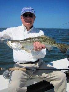 March is a great month to fish deep grass flats for trout and more. Alan Sugar, from MI, with a nice trout caught and released on an Ultra Hair Clouser fly while fishing Sarasota Bay with Capt. Rick Grassett in a previous March.