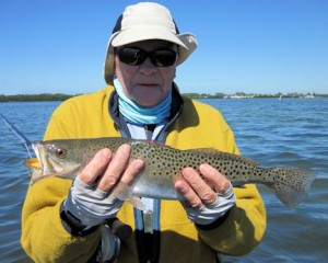 Nick Reding, from Longboat Key, FL, with a nice trout caught and released on a Grassett Flats Minnow fly while wading a Sarasota Bay shallow grass flat with Capt. Rick Grassett.