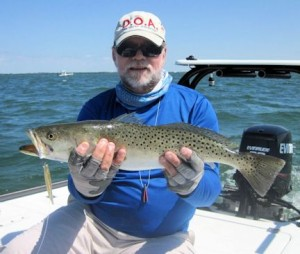 """Capt. Rick Grassett, with a 24""""  trout, caught and released on a weedless-rigged CAL jerk worm while fishing Sarasota Bay in the Sarasota CCA """"All Release Challenge"""" fishing tournament.  The fish won the largest overall trout in the Angler division."""
