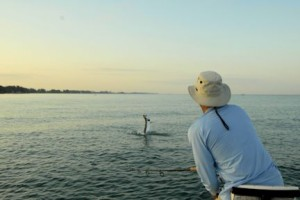 Domenick Raschella, from Roanoke, VA, jumps a tarpon in the coastal gulf while fishing with with Capt. Rick Grassett in a previous June.