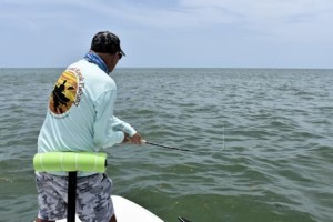 Steve Gibson, of Southern Drawl Kayak Fishing, battles a tarpon on fly tackle in the coastal gulf while fishing with Capt. Rick Grassett.