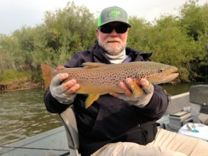 Capt. Rick with a Montana brown trout caught and released on a dry fly while fishing with guide Dave King, owner of King Outfitters.