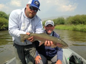 Guide Dave King, of King Outfitters, with a nice Montana rainbow caught and released by Mike Perez, from Sarasota, on a dry fly.