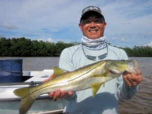 Jon Yenari, from Sarasota, with a snook caught and released on a top water plug while fishing Gasparilla Sound near Boca Grande with Capt. Rick Grassett in a previous November.