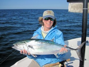 Nanette O'Hara, from Tampa, with a big albie caught and released on a Grassett Snook Minnow fly while fishing the coastal gulf in Sarasota with Capt. Rick Grassett in a previous November.