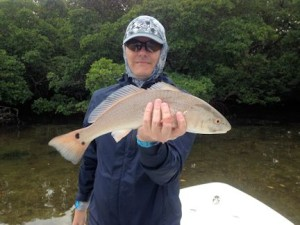 Kyle Ruffing , from Sarasota, with a red caught and released on a CAL Shad tail while fishing Tampa Bay with Capt. Rick Grassett.