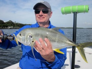 Rick Anderson, from IL, with a nice jack caught and released on a CAL jig with a shad tail while fishing Little Sarasota Bay with Capt. Rick Grassett.