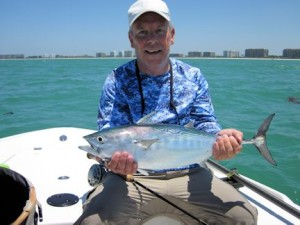 Mark Nielson, from Seaford, DE, with a false albacore caught and released on a Grassett Snook Minnow fly while fishing the coastal gulf with Capt. Rick Grassett.