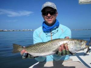Craig Henke, from Charleston, SC, with a nice trout caught and released on a CAL jig with a shad tail while fishing with Capt. Rick in a previous July.
