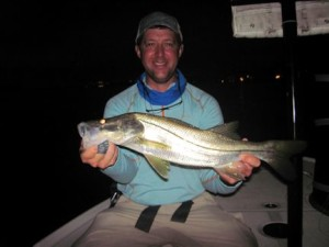 Craig Henke, from Charleston, SC, with a snook caught and released on a Grassett Snook Minnow fly while fishing with Capt. Rick in a previous July.