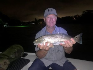 Kirk Grassett, from Middletown, DE, with a red caught and released on a fly while fishing Sarasota Bay with Capt. Rick Grassett.