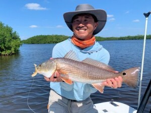 Jon Yenari, from Sarasota, with a  red caught and released on a CAL Shad while fishing Gasparilla Sound with Capt. Rick Grassett recently.